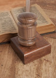 Wooden gavel and books Stock Photo