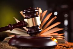 Wooden gavel and books on wooden table Stock Photography
