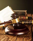 Wooden gavel and books on wooden table Stock Image