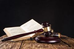 Wooden gavel and books on wooden table Royalty Free Stock Images
