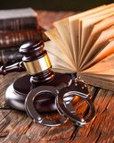 Wooden gavel and books on wooden table Royalty Free Stock Photos