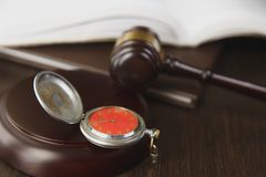 Wooden gavel and clock on paper calendar stock photography