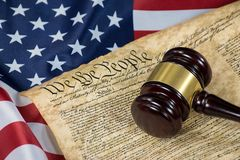 Wooden gavel on constitution document royalty free stock photo