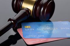 Wooden gavel with credit card Stock Photo
