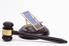 Wooden gavel and deck chair Royalty Free Stock Photo