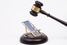 Wooden gavel and deck chair Royalty Free Stock Photos
