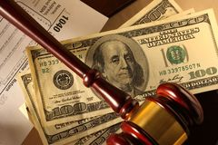 Wooden gavel and dollar Stock Images