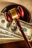 Wooden gavel and dollar banknotes Stock Photo