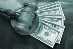 Wooden gavel and dollars Stock Photo