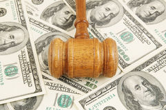 Wooden gavel on dollars background Royalty Free Stock Photos
