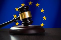 Wooden gavel with European Union flag in background Stock Images