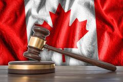 Wooden gavel and flag of Canada on background - law concept. 3D rendered illustration Stock Photos