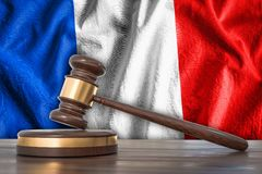 Wooden gavel and flag of France on background - law concept. 3D rendered illustration Royalty Free Stock Image