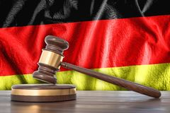 Wooden gavel and flag of Germany on background - law concept. 3D rendered illustration Royalty Free Stock Photos