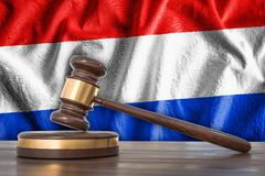 Wooden gavel and flag of Netherlands on background - law concept. 3D rendered illustration Stock Photography