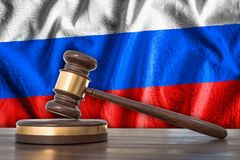 Wooden gavel and flag of Russia on background - law concept. 3D rendered illustration Royalty Free Stock Photography