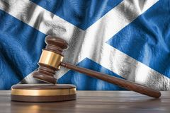 Wooden gavel and flag of Scotland on background - law concept. 3D rendered illustration Stock Image