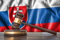 Wooden gavel and flag of Slovakia on background - law concept. 3D rendered illustration Royalty Free Stock Image