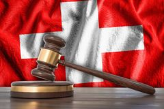 Wooden gavel and flag of Switzerland on background - law concept. 3D rendered illustration Royalty Free Stock Image