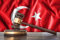 Wooden gavel and flag of Turkey on background - law concept. 3D rendered illustration Royalty Free Stock Photography