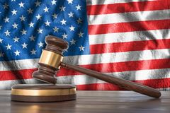 Wooden gavel and flag of USA on background - law concept. Wooden gavel and flag of United States of America on background - law concept. 3D rendered illustration Royalty Free Stock Photos