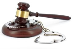 Wooden Gavel and handcuffs Stock Image