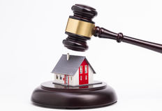 Wooden gavel and a house Royalty Free Stock Image