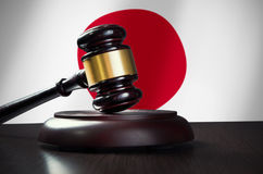 Wooden gavel with Japenese flag in background. Justice and law symbol Royalty Free Stock Photography
