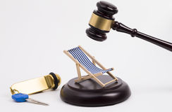 Wooden gavel with key and deck chair Royalty Free Stock Images