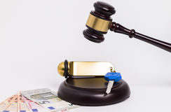 Wooden gavel with key and money Stock Photo