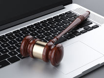 Wooden gavel on laptop Royalty Free Stock Photography