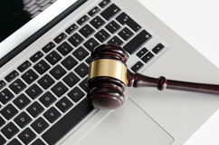 Wooden gavel on laptop keyboard Stock Image