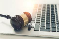 Wooden gavel on laptop keyboard Royalty Free Stock Photo