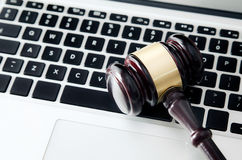 Wooden gavel on laptop keyboard Royalty Free Stock Photo