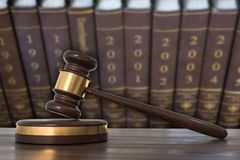 Wooden gavel and law books in lawyers office stock illustration