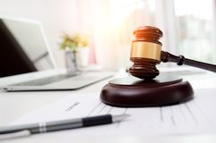 Wooden gavel at lawyer or attorney office. Law in technology, justice concept Stock Images