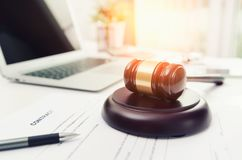 Wooden gavel at lawyer or attorney office. stock photo