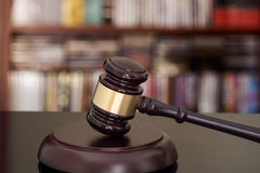 Wooden gavel on library background Stock Image