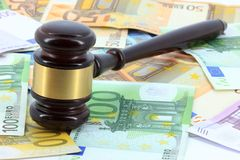 Wooden gavel and money Stock Photo