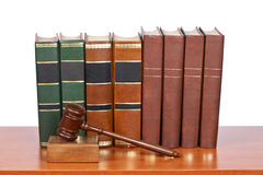 Wooden gavel and old law books Royalty Free Stock Images