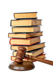 Wooden gavel and old law books Stock Photos