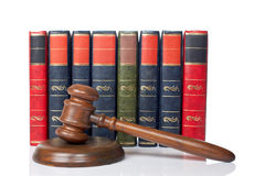 Wooden gavel and old law books Royalty Free Stock Photos