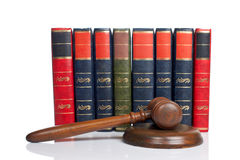 Wooden gavel and old law books Royalty Free Stock Photo