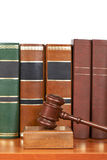 Wooden gavel and old law books Royalty Free Stock Image
