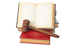 Wooden gavel and old opened law book Stock Photo