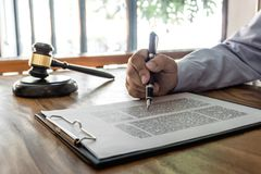 Free Wooden Gavel On Table, Law, Lawyer Attorney And Justice Concept, Male Lawyer Working On A Documents And Report Of The Important Royalty Free Stock Images - 136934849