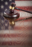 Wooden Gavel Resting on Flag Reflecting Table Stock Photography