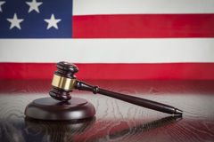 Wooden Gavel Resting on Flag Reflecting Table Stock Photos