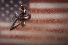 Wooden Gavel Resting on Flag Reflecting Table Stock Images