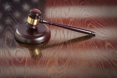 Wooden Gavel Resting on Flag Reflecting Table Royalty Free Stock Photo